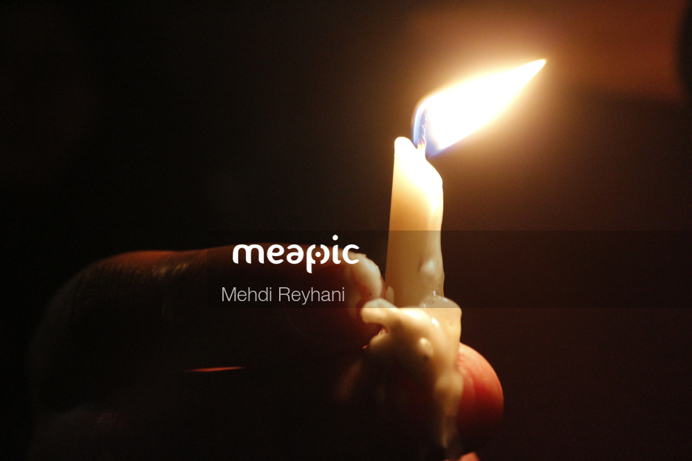 Hand Holding A Candle Stock Photo · Meapic