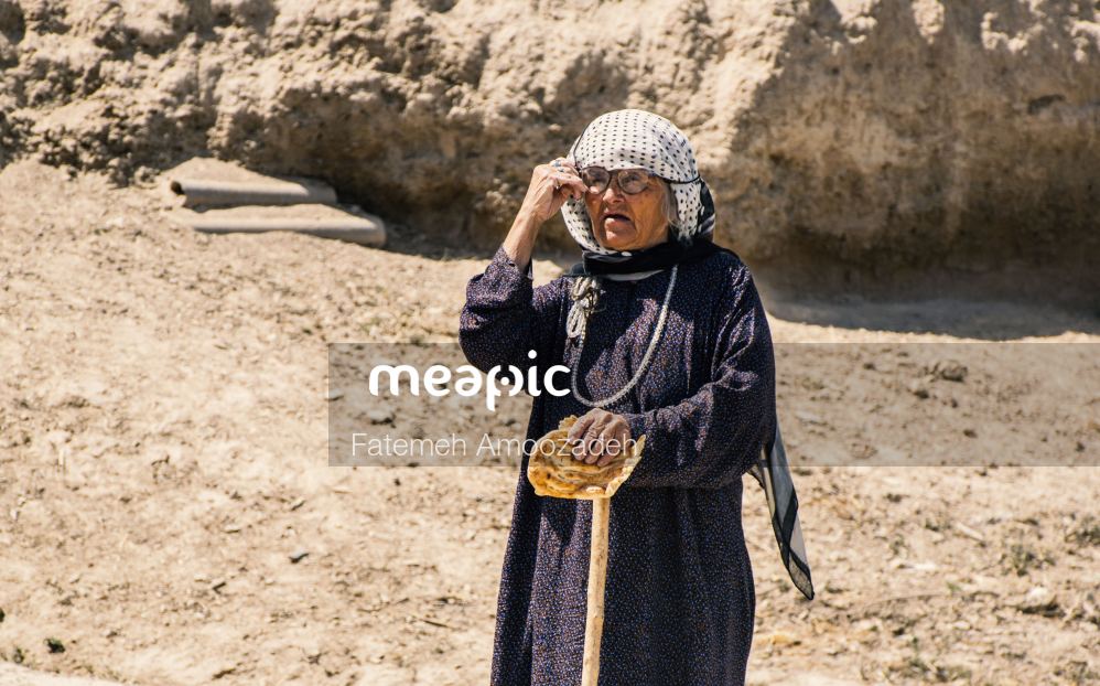 Person That Is Standing In The Dirt Stock Photo · Meapic