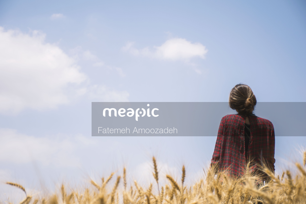 Person Standing In Front Of A Tree Stock Photo · Meapic