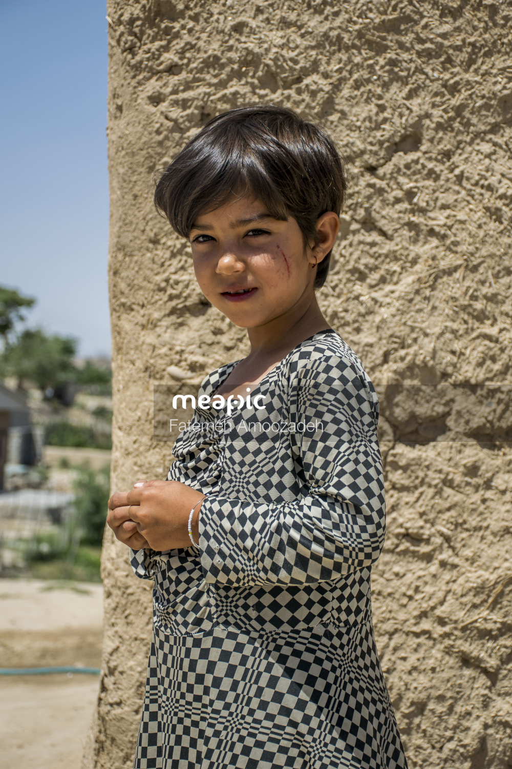 Little Boy That Is Standing In The Dirt Stock Photo · Meapic
