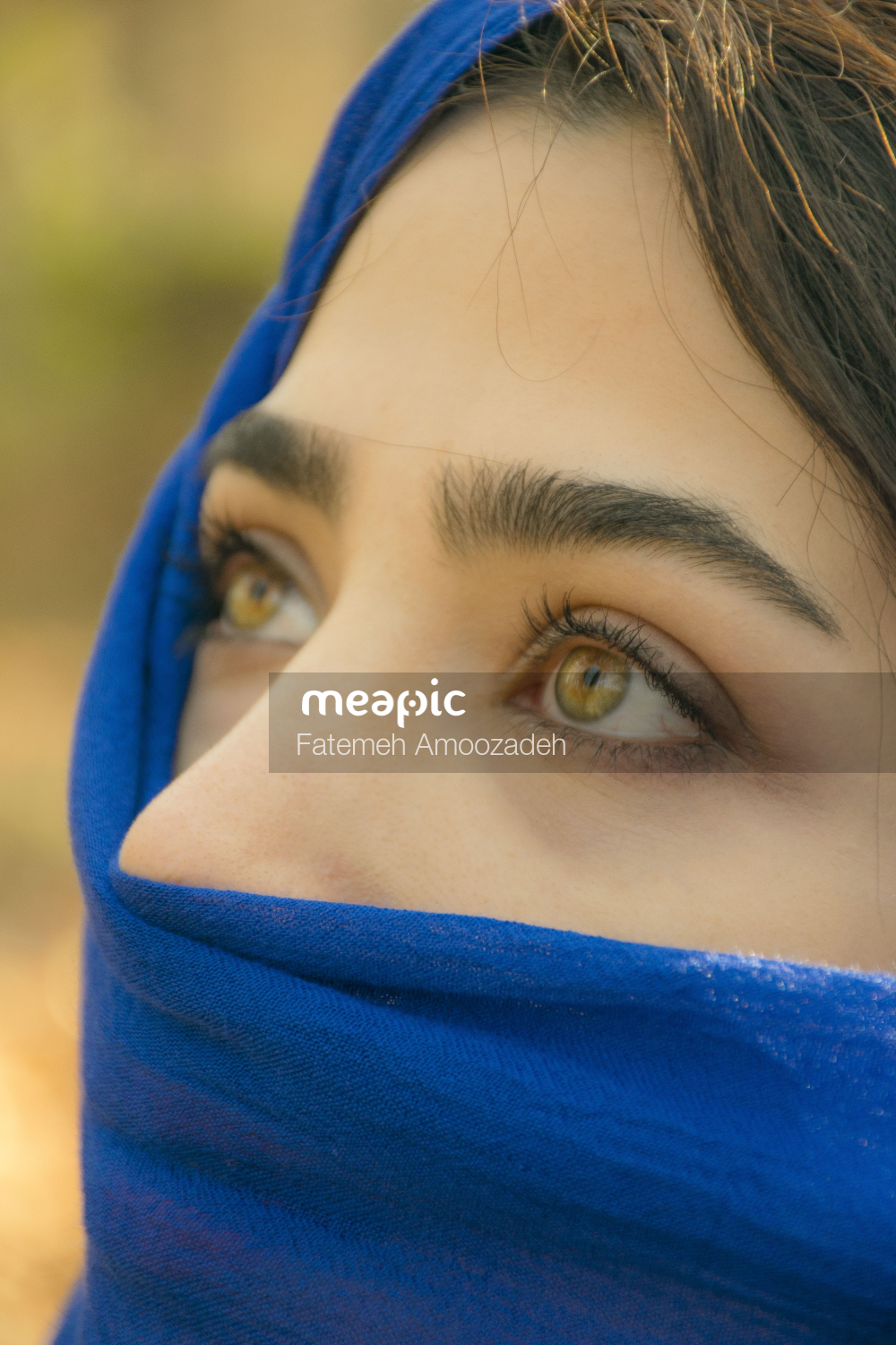 Close Up Of A Woman In A Blue Shirt Stock Photo · Meapic