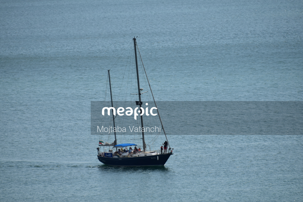 Small Boat In A Large Body Of Water Stock Photo · Meapic