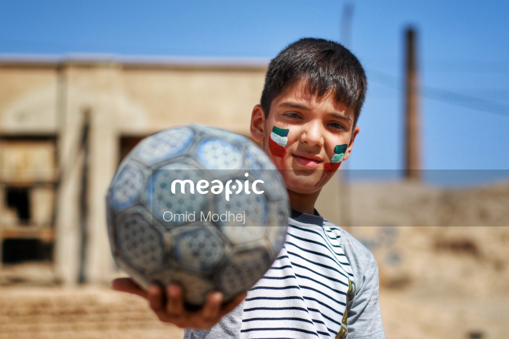 Man With A Football Ball Stock Photo · Meapic