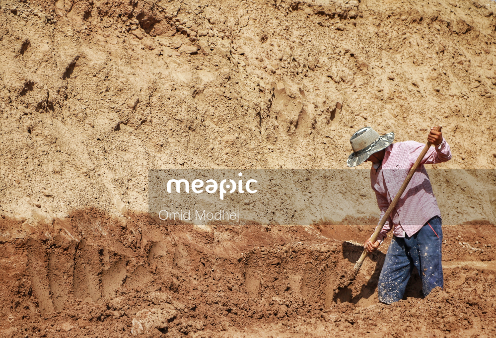 Man That Is Standing In The Dirt Stock Photo · Meapic