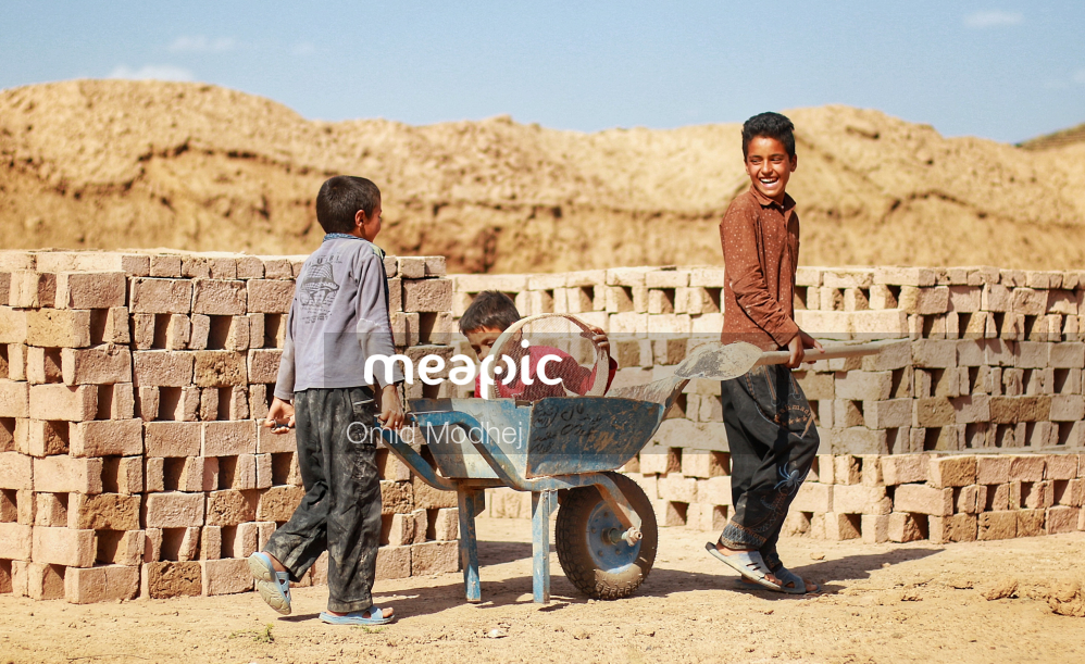Group Of People Standing In Front Of A Fence Stock Photo · Meapic