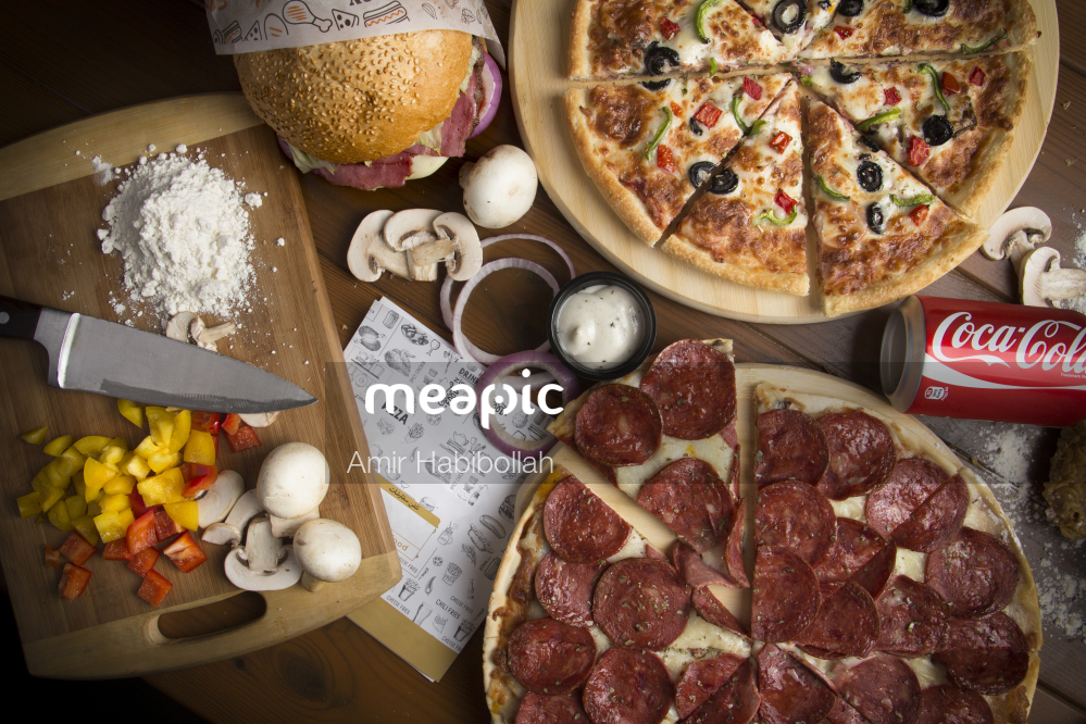 Bunch Of Food Sitting On A Table Stock Photo · Meapic