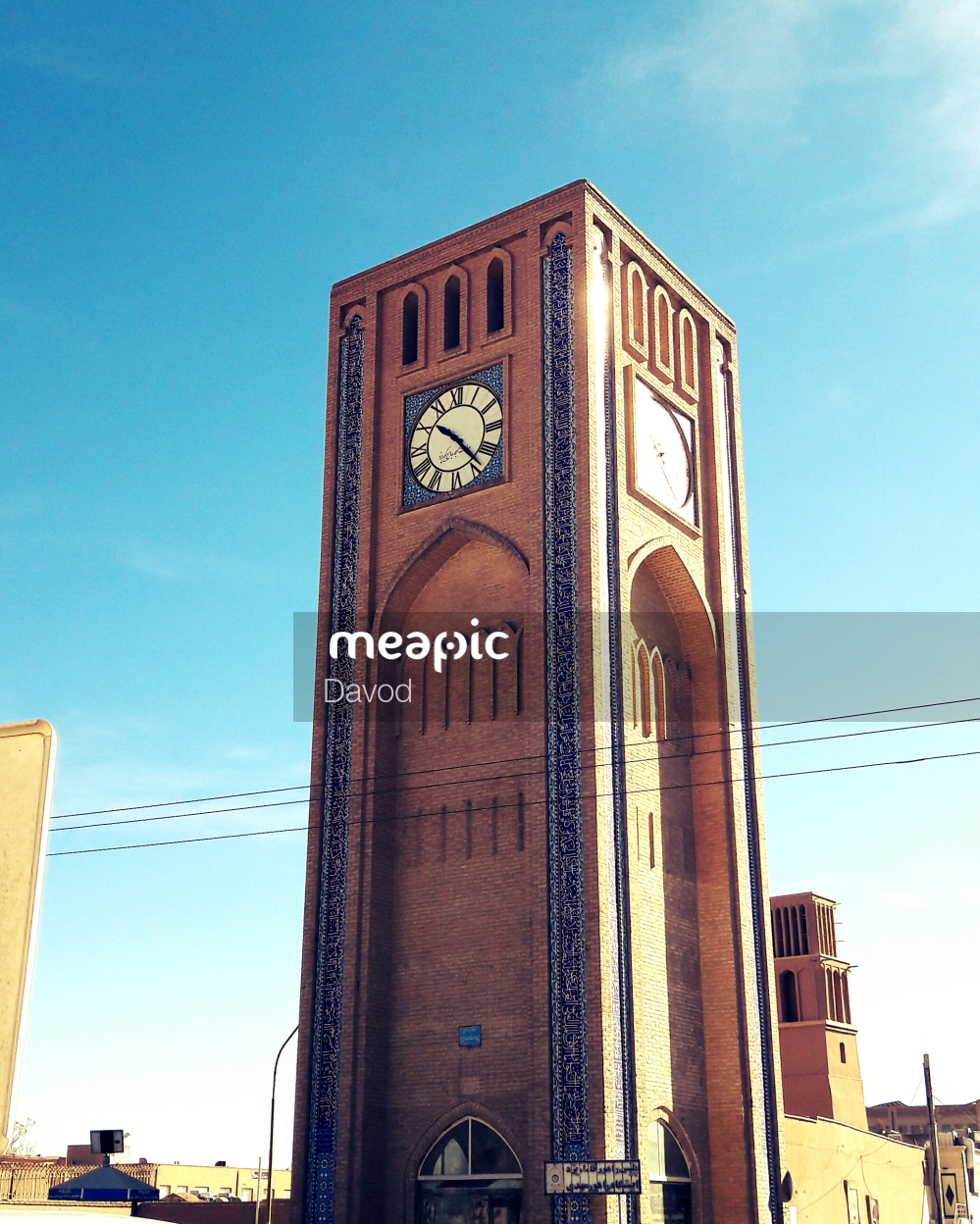 Large Clock Tower Towering Over A City Stock Photo · Meapic