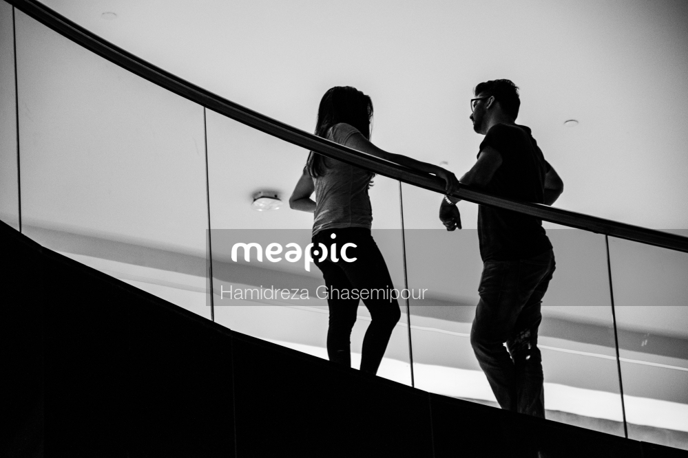 Person Standing In Front Of A Mirror Posing For The Camera Stock Photo · Meapic