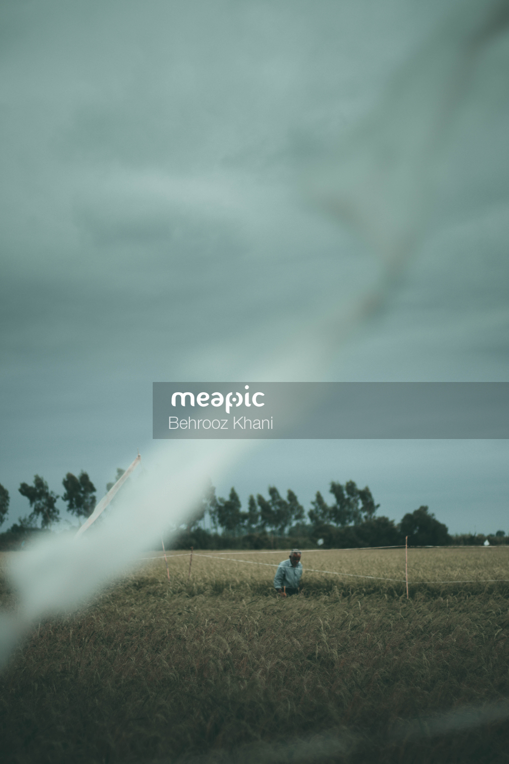Rainbow Over A Field Stock Photo · Meapic
