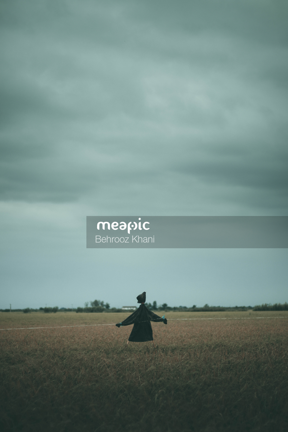 Person Standing On Top Of A Grass Covered Field Stock Photo · Meapic