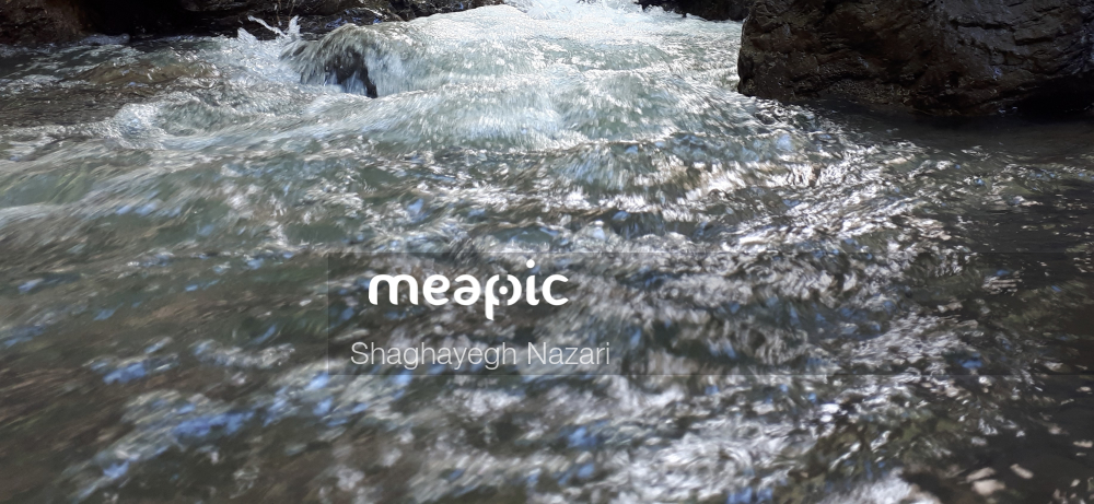 Waterfall Going Over A Body Of Water Stock Photo · Meapic