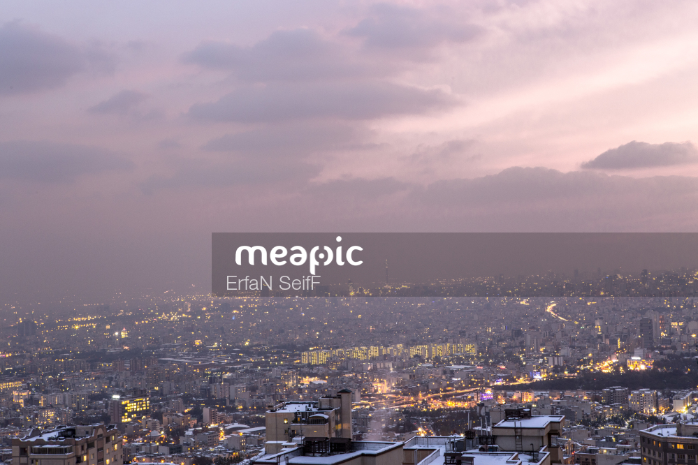 Large Body Of Water With A City In The Background Stock Photo · Meapic