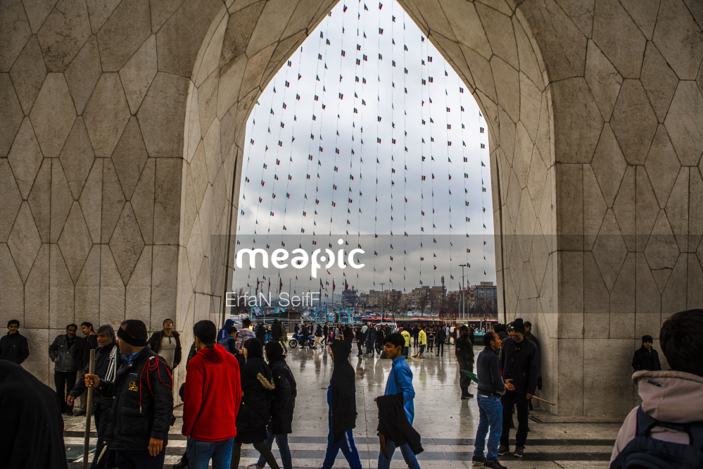 Group Of People Standing In Front Of A Crowd Stock Photo · Meapic