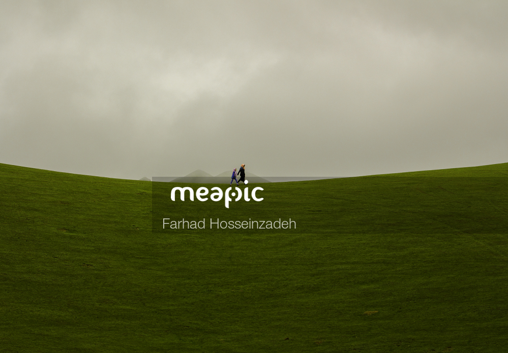 Person In A Green Field Stock Photo · Meapic