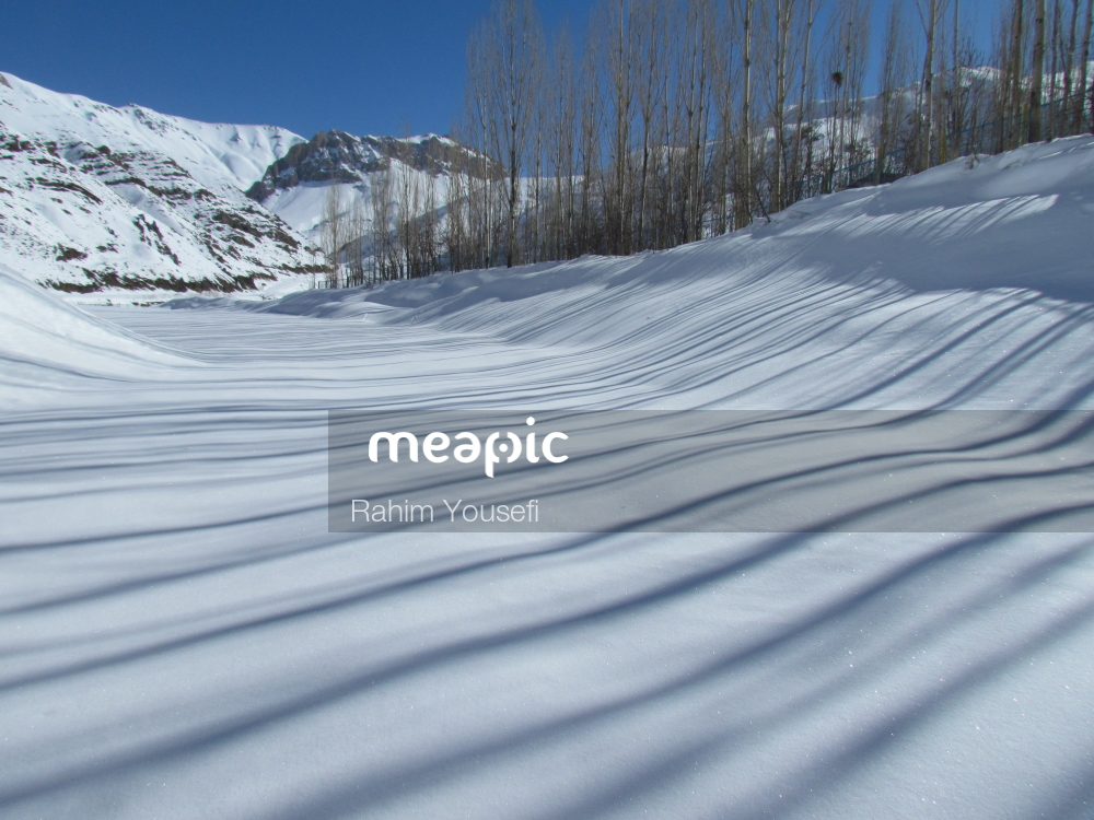 Man Riding Skis Down A Snow Covered Slope Stock Photo · Meapic