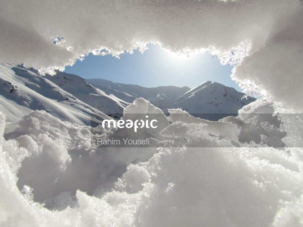 Group Of Clouds In The Sky Over A Snow Covered Mountain Stock Photo · Meapic