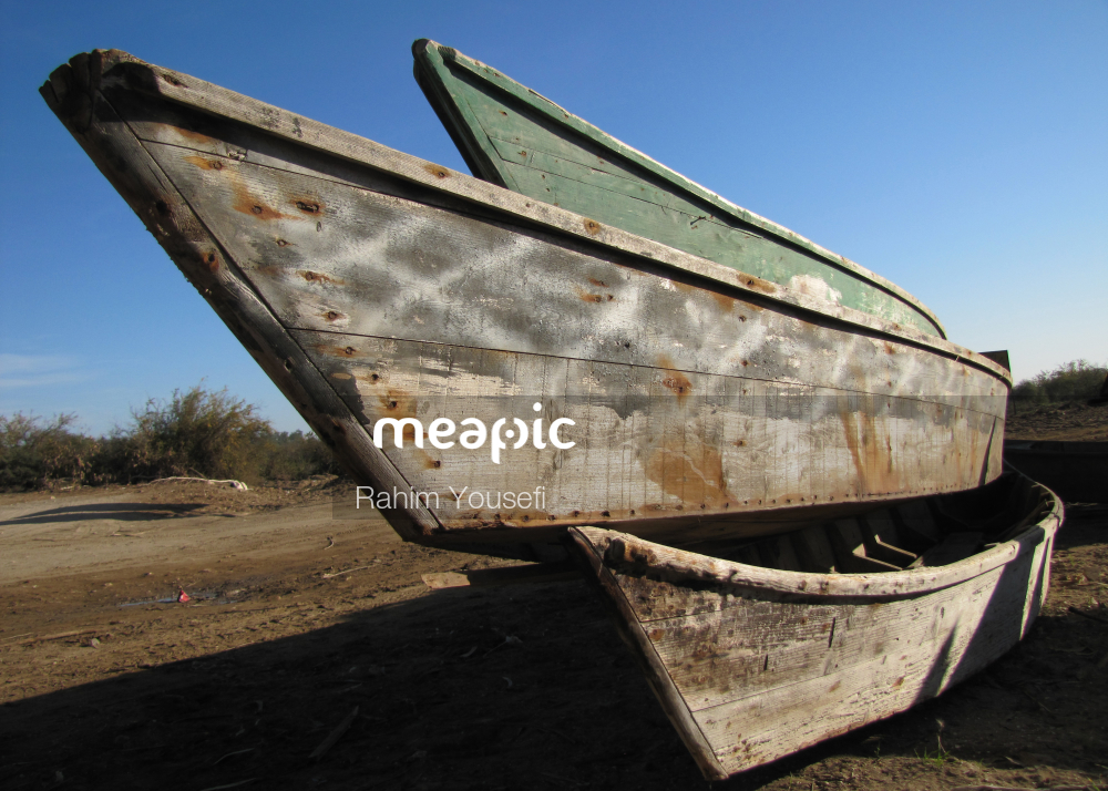 Boat Sitting On Top Of A Sandy Beach Stock Photo · Meapic