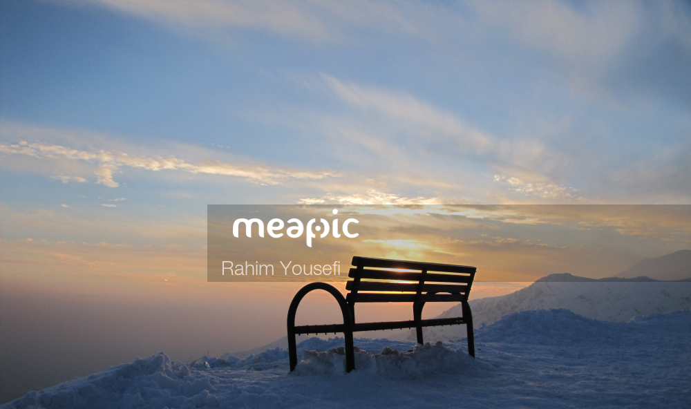 Bench Overlooking The Ocean At Sunset Stock Photo · Meapic