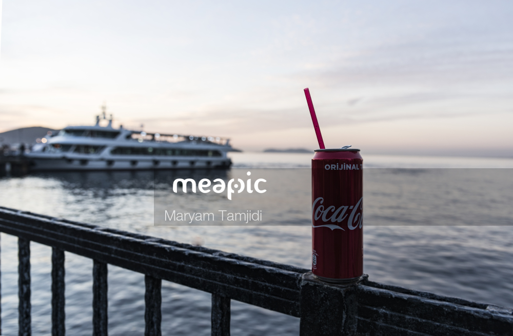 Boat Sitting On Top Of A Pier Next To A Body Of Water Stock Photo · Meapic