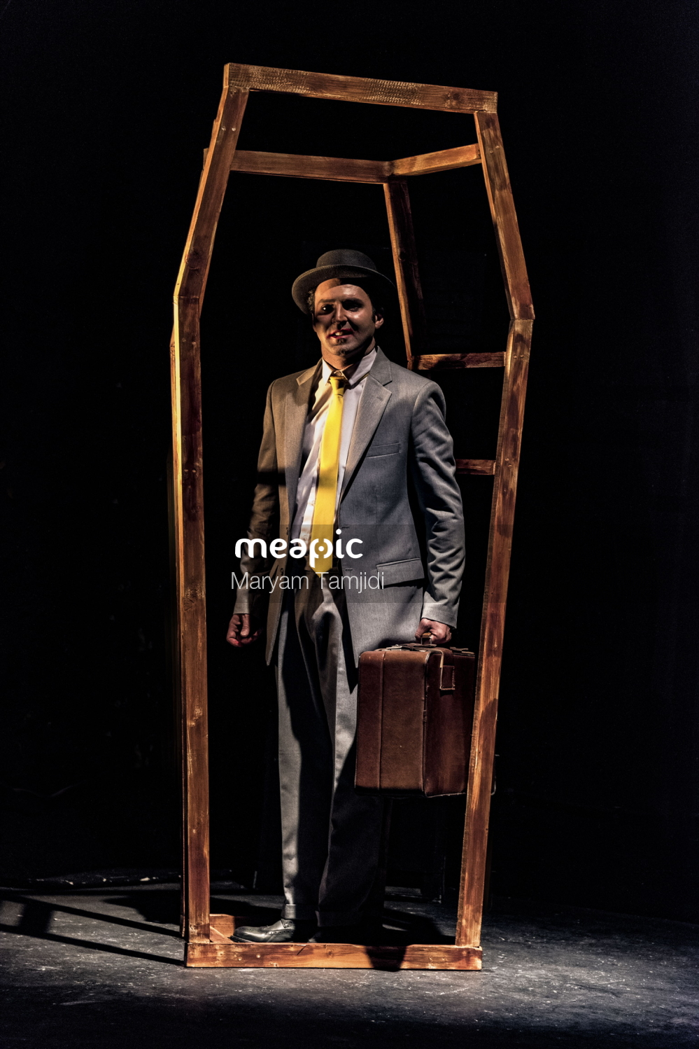 Man Wearing A Suit And Tie Standing In Front Of A Door Stock Photo · Meapic