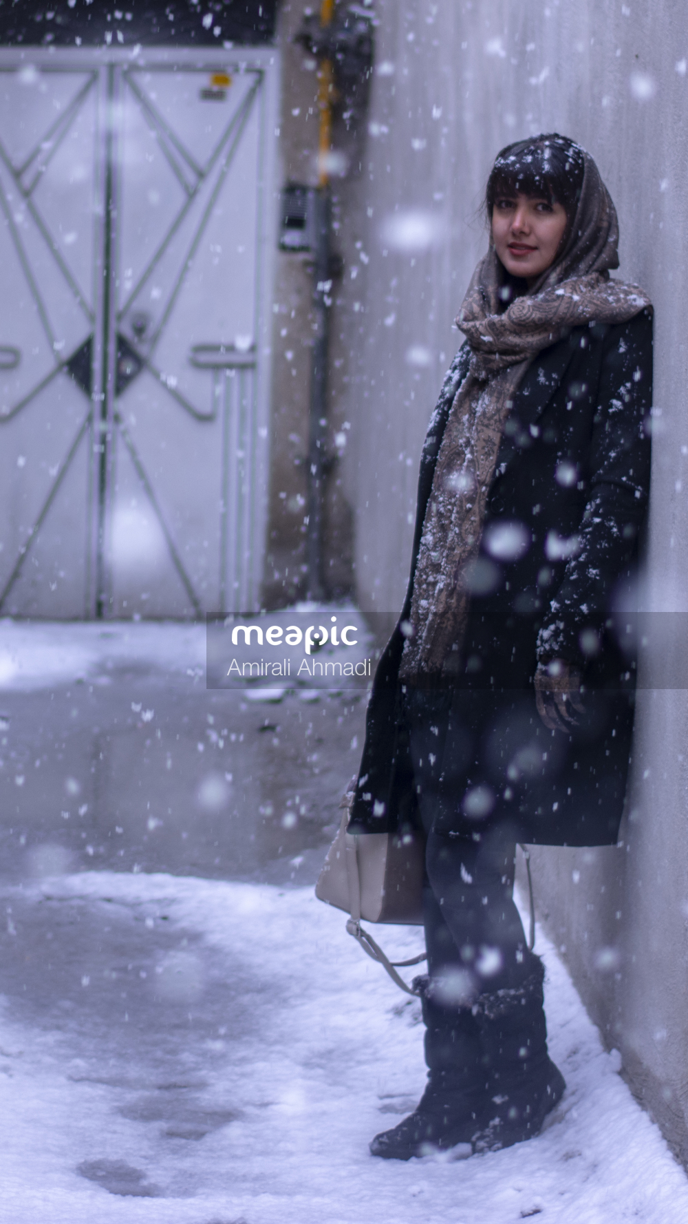 Person That Is Standing In The Snow Stock Photo · Meapic