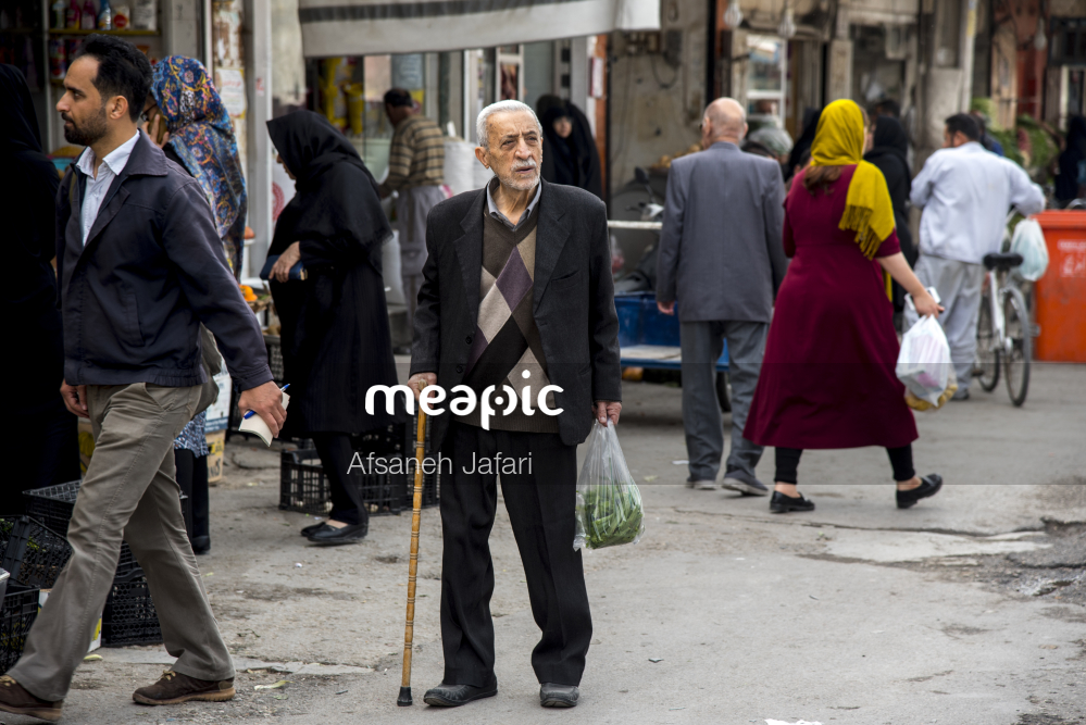 Group Of People Walking Down The Street Stock Photo · Meapic