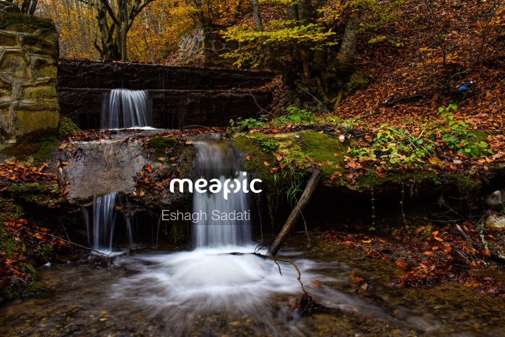 Large Waterfall Over A Body Of Water Stock Photo · Meapic