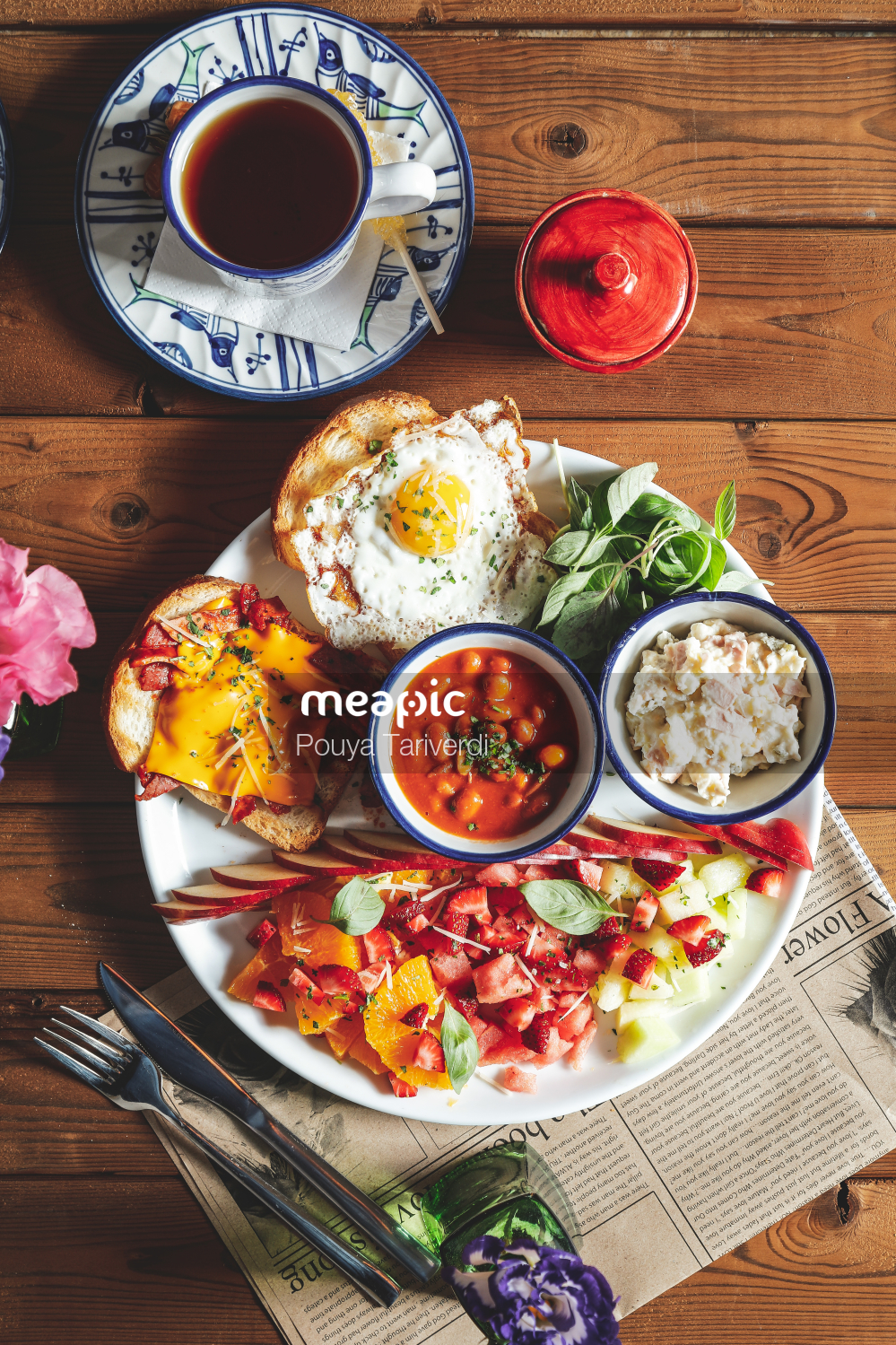 Plate Of Food On A Wooden Table Stock Photo · Meapic
