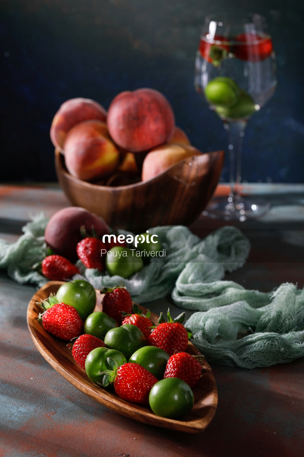 Bowl Of Fruit Sitting On A Table Stock Photo · Meapic