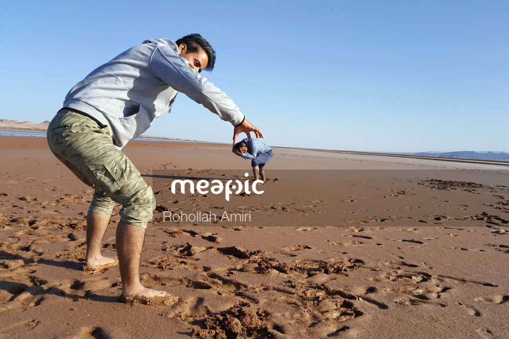Man Standing On A Beach Stock Photo · Meapic