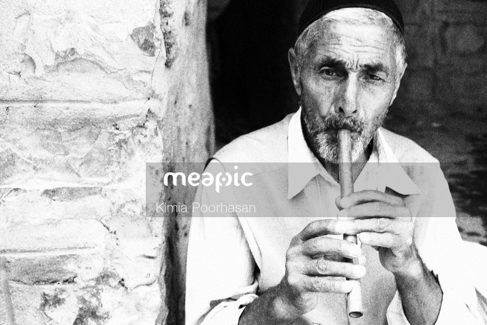 Man Holding His Hand Up To His Mouth Stock Photo · Meapic