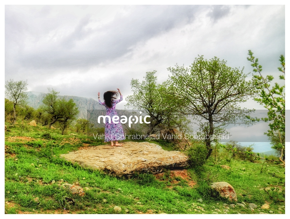 Person Standing On A Grassy Hill Stock Photo · Meapic