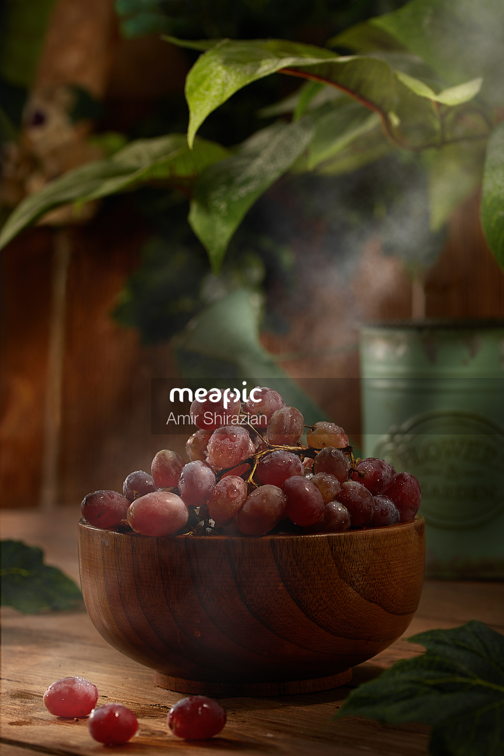 Bowl Of Fruit Sitting On Top Of A Wooden Table Stock Photo · Meapic