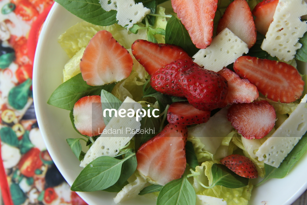 Bowl Of Fruit And Vegetable Salad On A Plate Stock Photo · Meapic