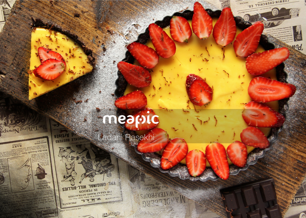 I Am Not Really Confident, But Slice Of Pizza On A Cutting Board With A Cake Stock Photo · Meapic