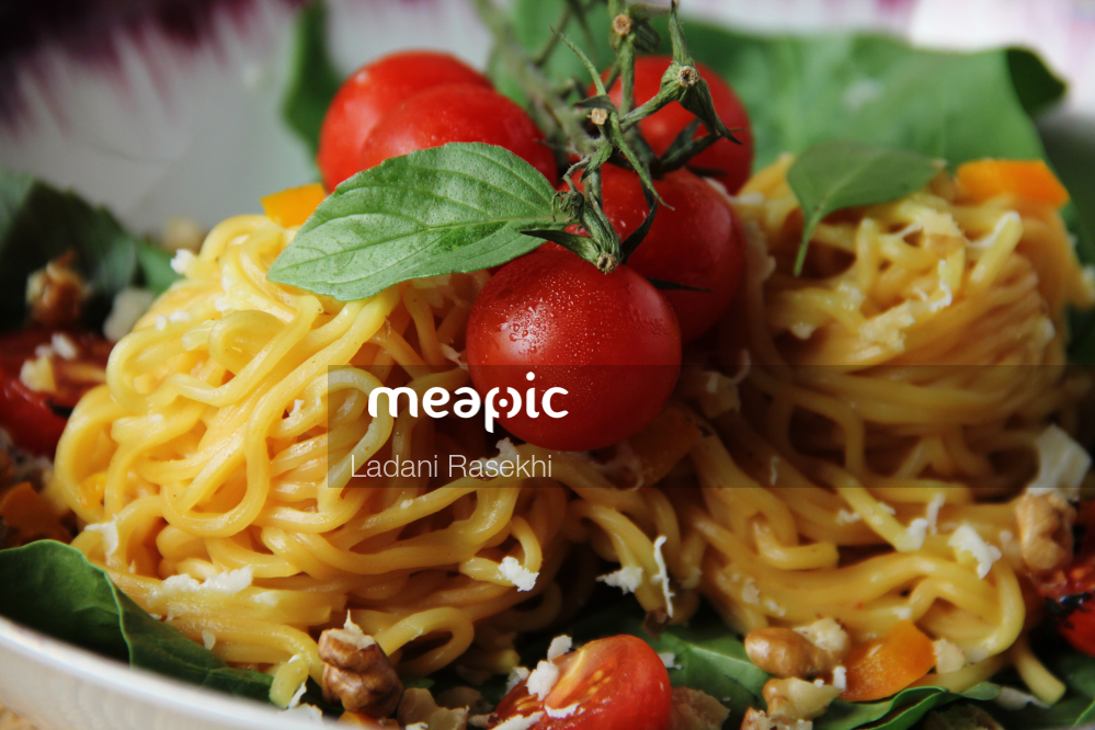 Bowl Of Pasta Salad On A Plate Stock Photo · Meapic