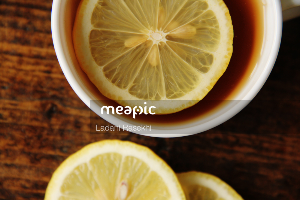 Close Up Of A Slice Of Orange In A Bowl Stock Photo · Meapic