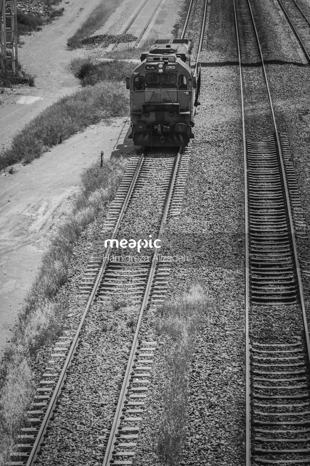 Train Is Coming Down The Railroad Tracks Stock Photo · Meapic