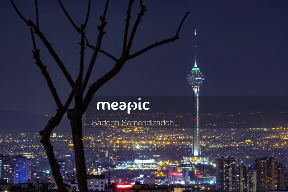 View Of A City At Night Stock Photo · Meapic