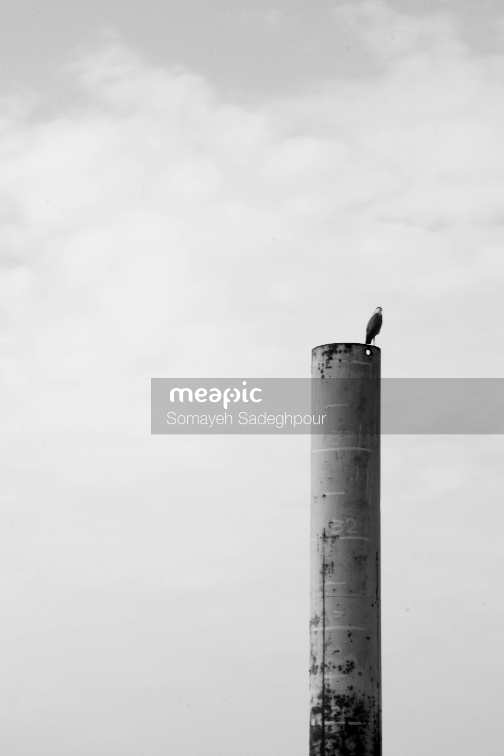 White And Black Tower On A Cloudy Day Stock Photo · Meapic