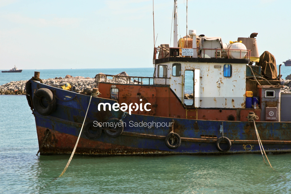 Small Boat In A Body Of Water Stock Photo · Meapic