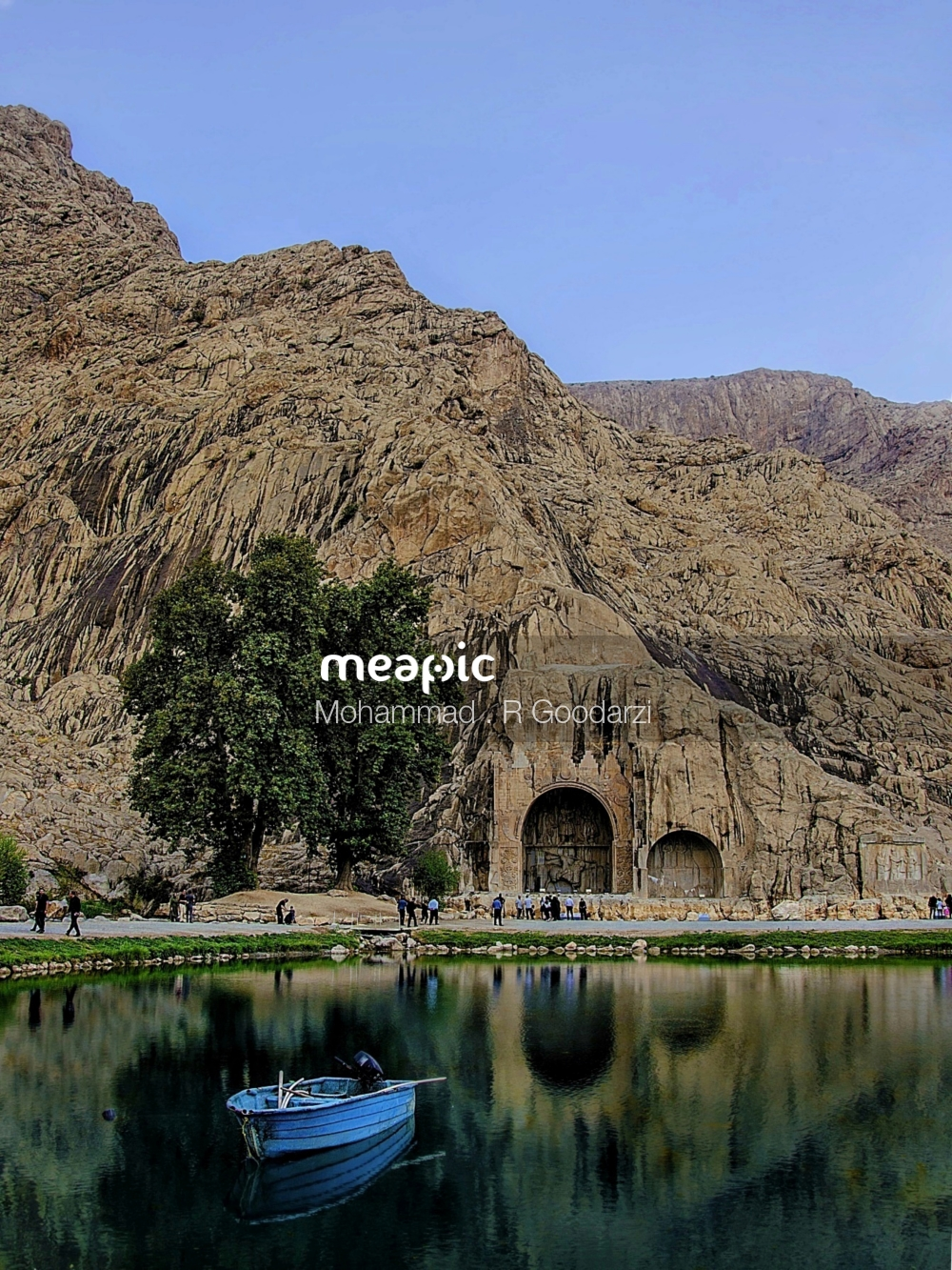 Bridge Over A Body Of Water With A Mountain In The Background Stock Photo · Meapic
