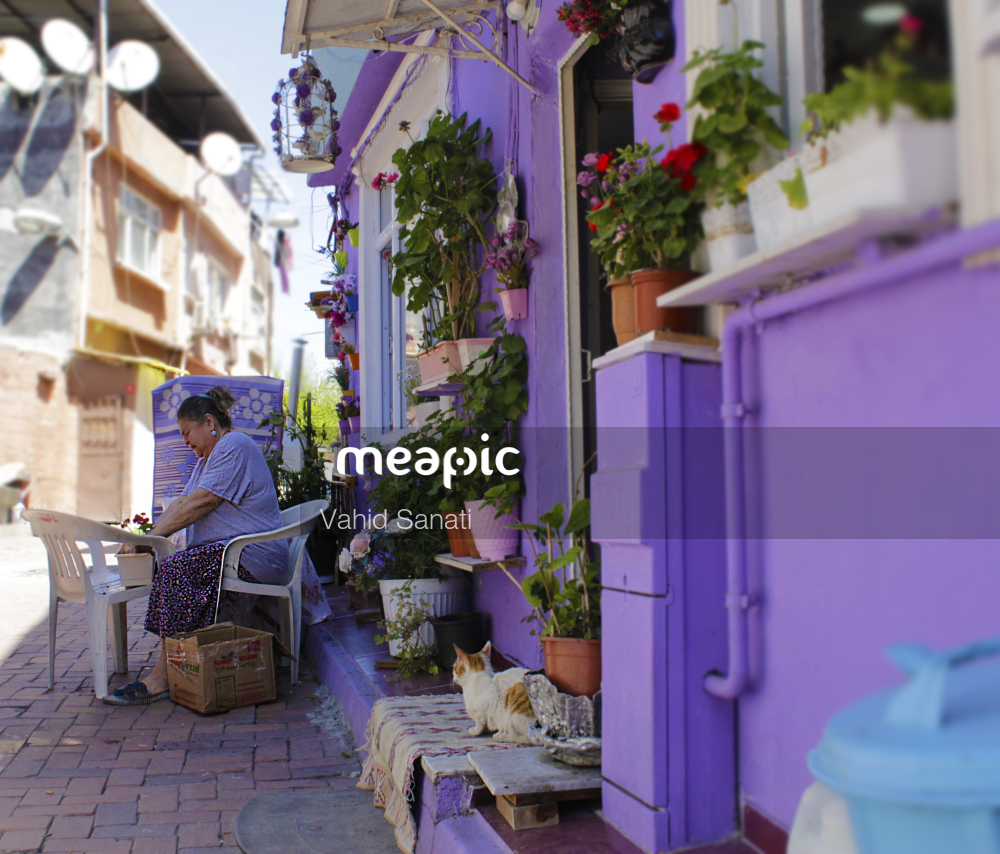 Person Standing In Front Of A Building Stock Photo · Meapic