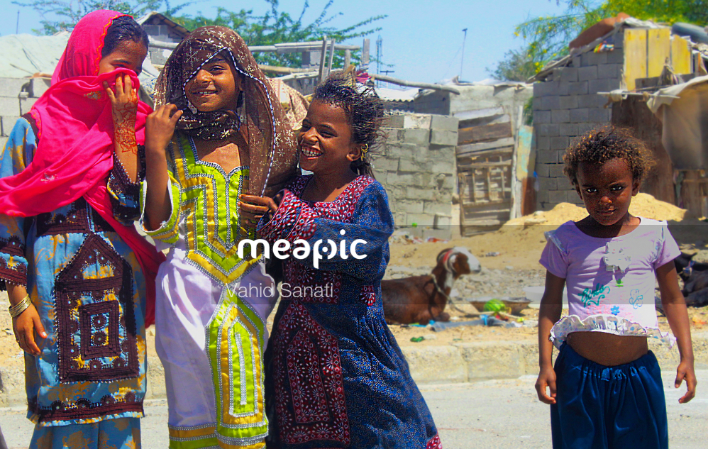 Group Of People Standing Next To A Child Stock Photo · Meapic