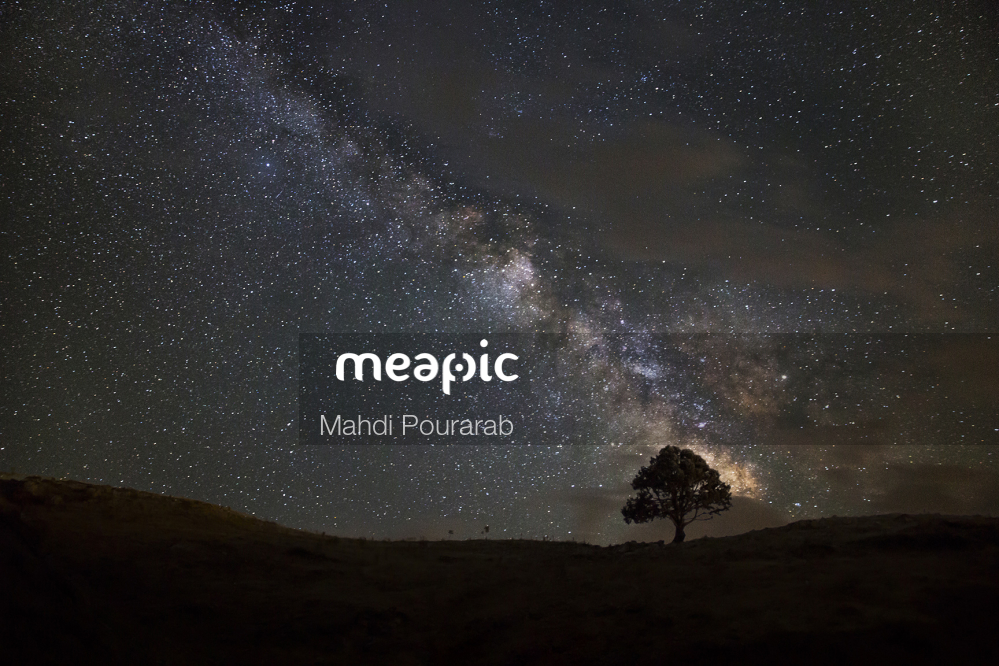 Person Standing In A Dark Sky Stock Photo · Meapic