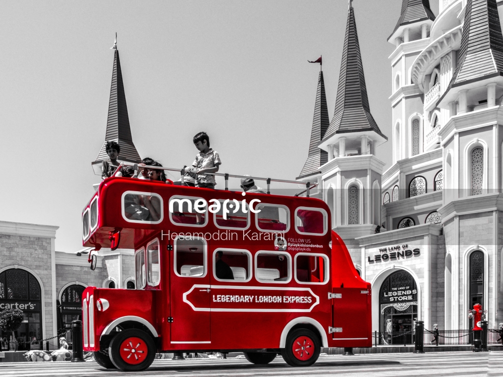 Red Double Decker Bus Parked In Front Of A Building Stock Photo · Meapic