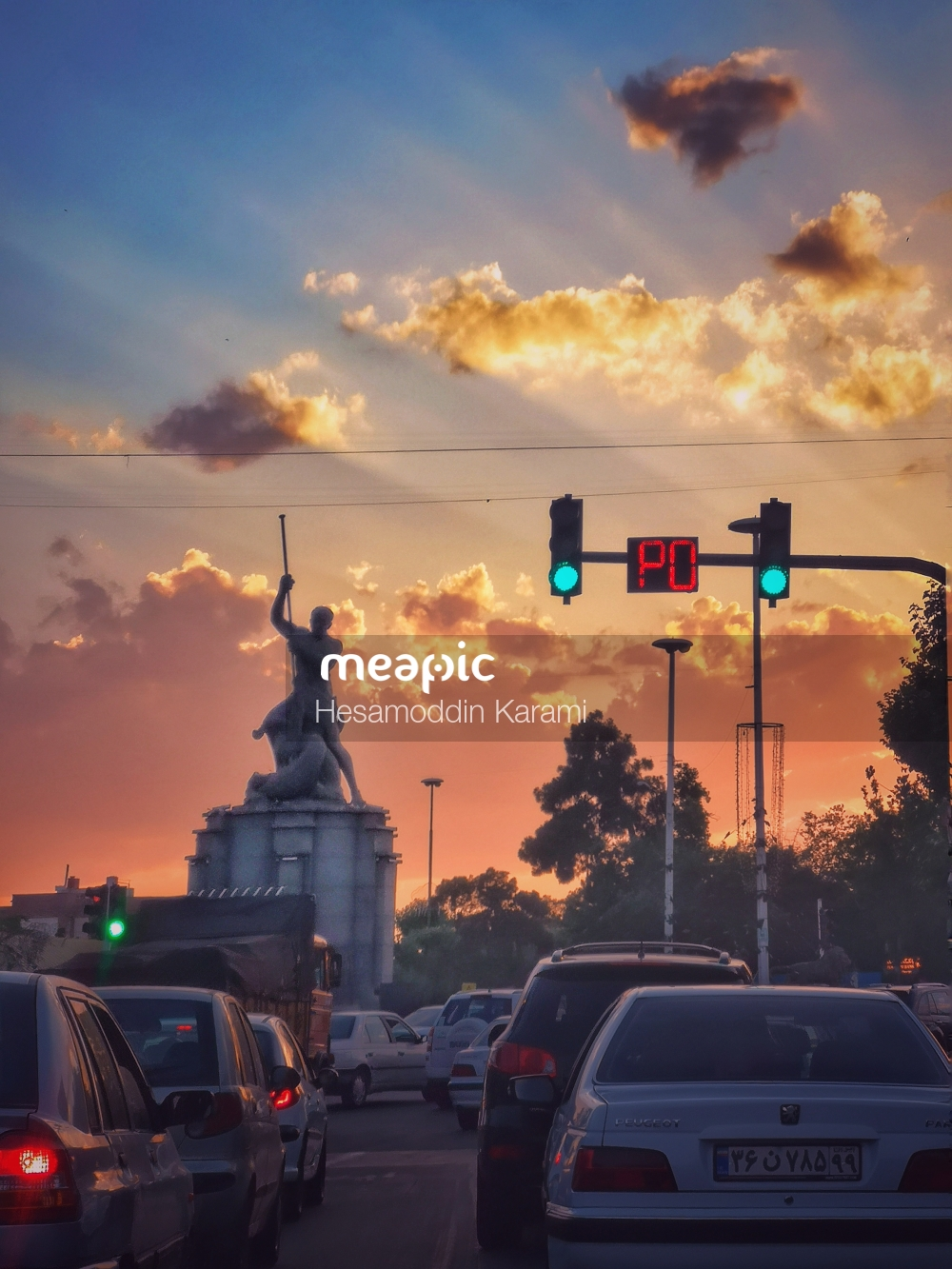 Car Stopped At A Traffic Light Hanging Off The Side Of A Road Stock Photo · Meapic