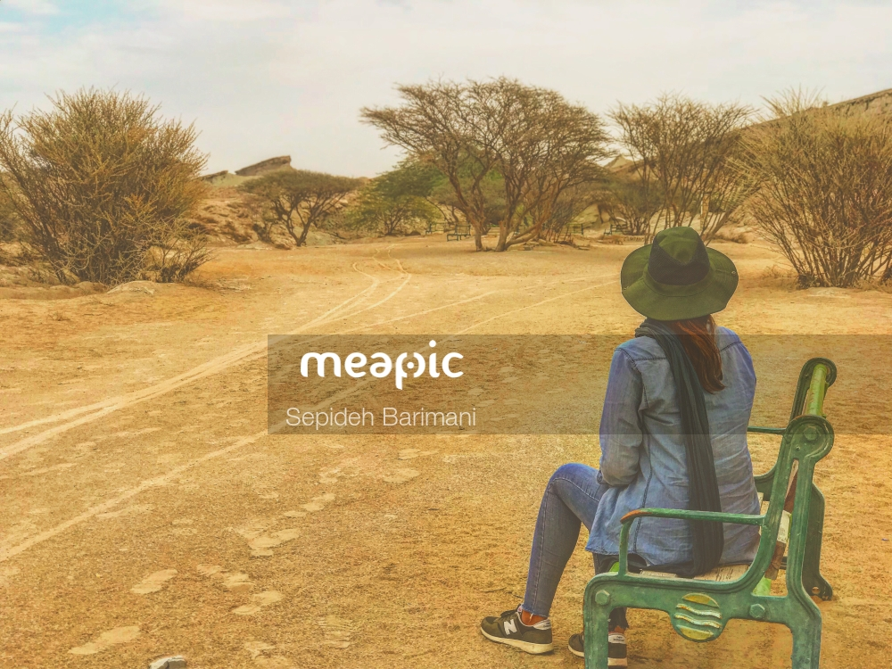 Person Riding A Bike Down A Dirt Road Stock Photo · Meapic