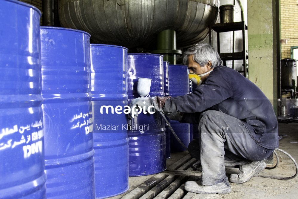 Person Standing In Front Of A Barrel Stock Photo · Meapic