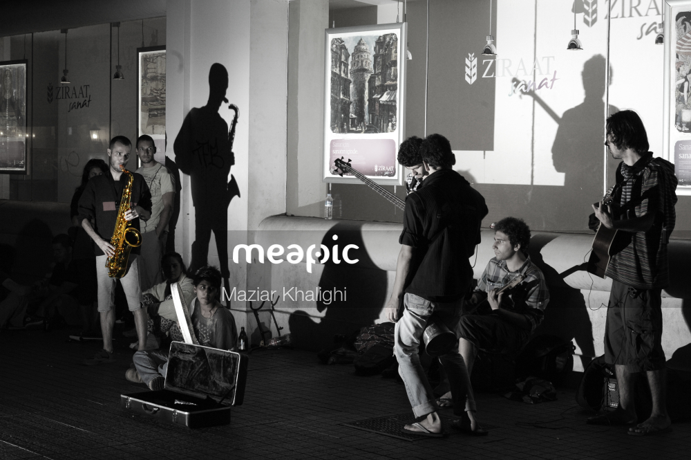 Group Of People Standing In A Room Stock Photo · Meapic